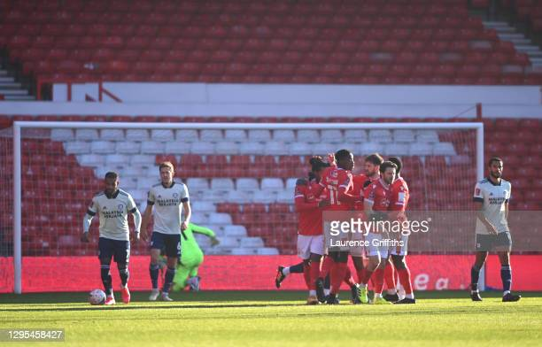 Lyle Taylor of Nottingham Forest celebrates with teammates after scoring his team's first goal during the FA Cup Third Round match between Nottingham...