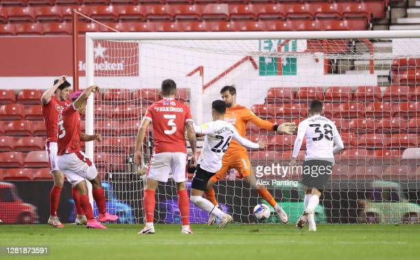 Lyle Taylor of Nottingham Forest scores his team's first goal during the Sky Bet Championship match between Nottingham Forest and Brentford at City...