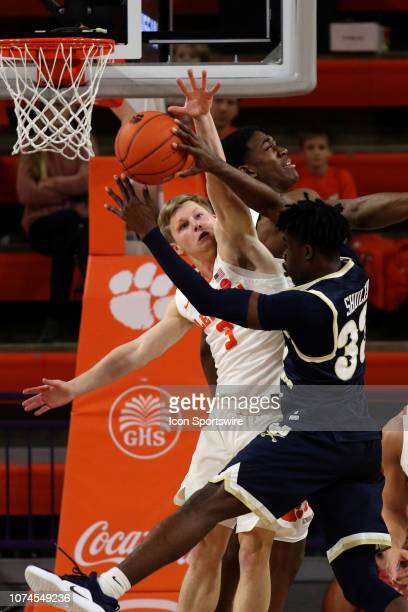 Lyles Davis guard of Clemson tries to block a shot during a college basketball game between the Charleston Southern Buccaneers and the Clemson Tigers...