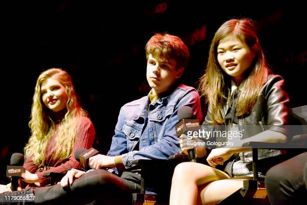 Lyliana Wray, Sam Ashe Arnold, Miya Cech speak onstage during Nickelodeon's Are You Afraid of the Dark? panel at New York Comic Con 2019 - Day 2 at...