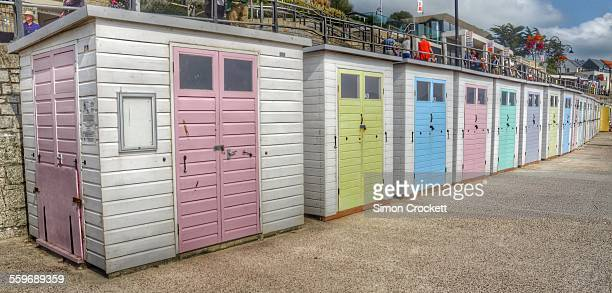 lyme regis beach huts - simon crockett stock pictures, royalty-free photos & images