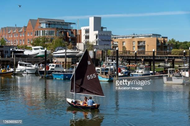 Lymington, Hampshire, England, UK, Family sailing a Laser Radial sailing boat on the Lymington River.