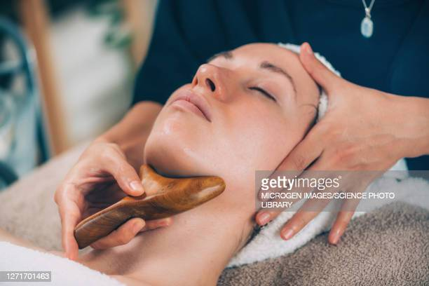 lymphatic drainage face massage - drain stock pictures, royalty-free photos & images