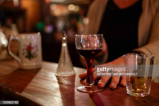 Lynda, an ex-madam and actual owner of the Cotton Club bar, formerly an escort-girl bar, sits in her establishment in the Pigalle area of Paris, on...