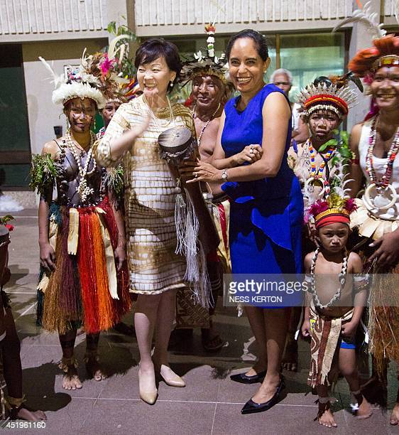 Lynda Babao wife of Papua New Guinea Prime Minister Peter O'Neil and Akie Abe wife of Japan's Prime Minister Shinzo Abe are treated to some...