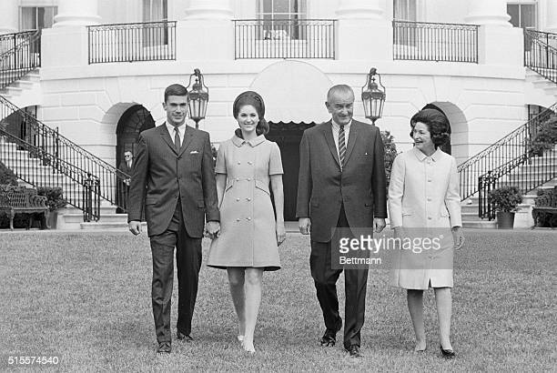 Lynda Bird Johnson and her fiance Marine Capt Charles Robb are joined by Pres and Mrs Johnson during a picturetaking session on the White House lawn...