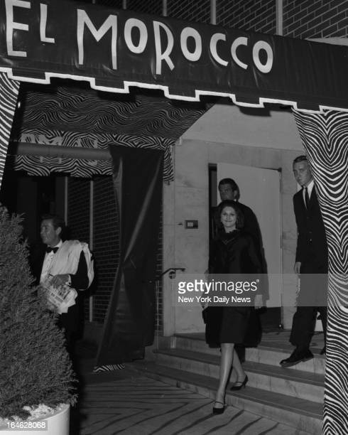 Lynda Bird Johnson steps out escorted by George Hamilton leaves El Morocco after a late evening nightcap