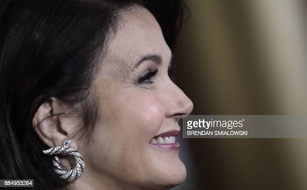 Lynda Carter arrives for the 40th Annual Kennedy Center Honors in Washington DC on December 3 2017 / AFP PHOTO / Brendan SMIALOWSKI