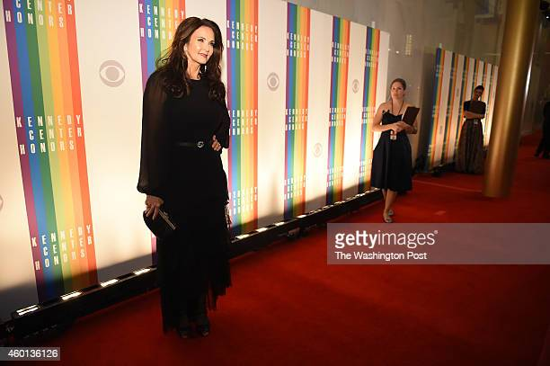 Lynda Carter walks the red carpet before the start of the Kennedy Center Honors at the John F. Kennedy Center for the Performing Arts on Sunday...