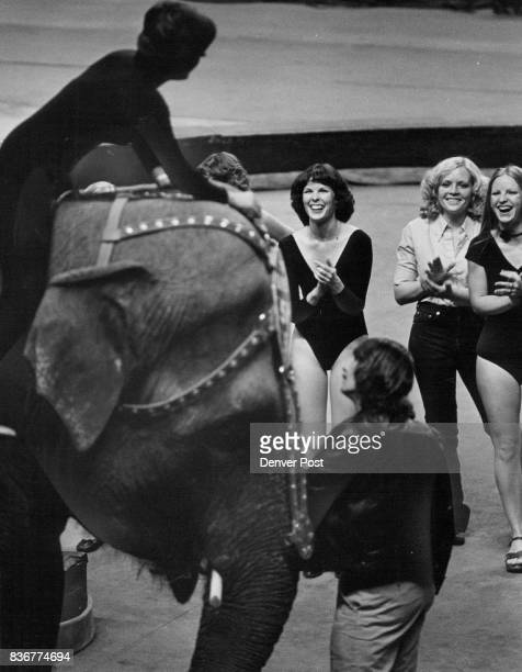 Lynda hatfield Center and others Applaud a Lesson head circus showgirl SueSue Sparkman shows how to ride an elephant Credit Denver Post
