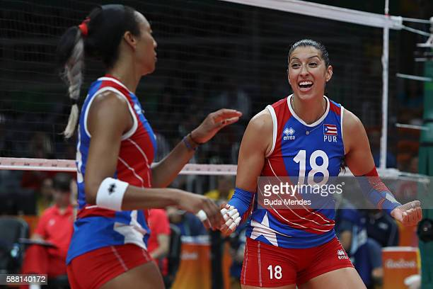 Lynda Morales of Puerto Rico celebrates a point during the women's qualifying volleyball match between the China and Puerto Rio on Day 5 of the Rio...