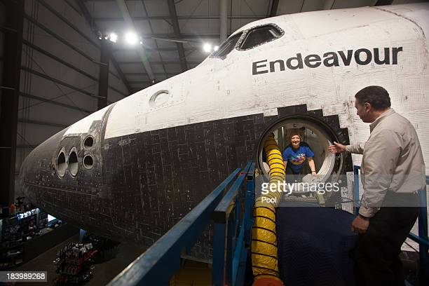 Lynda Oschin is helped out of the Endeavour after a tour with CSC president Jeffrey Rudolph celebrating the one year anniversary of Endeavour's...