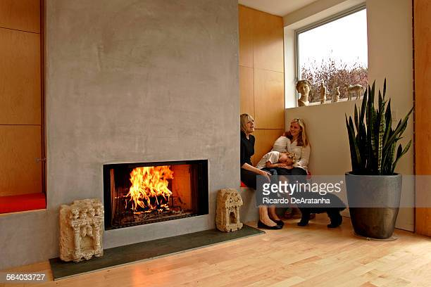 Lynda Taylor left sitting by the fireplace talking with Emily Kovner and children Miller Moss and Addison Moss 10 weeks They are in Taylor's new...