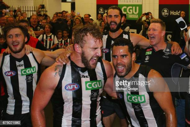 Lynden Dunn and Daniel Wells of the Magpies celebrate their first win with the club during the round six AFL match between the Geelong Cats and the...
