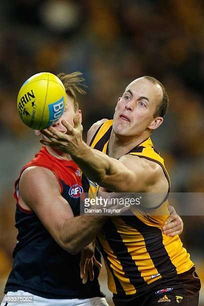 Lynden Dunn of the Demons and David Hale of the Hawks compete during the round 20 AFL match between the Hawthorn Hawks and the Melbourne Demons at...