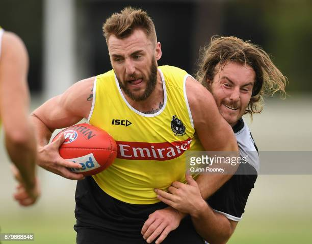 Lynden Dunn of the Magpies is tackled by Tim Broomhead during a Collingwood Magpies AFL training session at Holden Centre on November 27 2017 in...