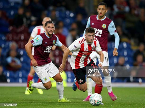 Lynden Gooch of Sunderland AFC battles for possession with Daniel Drinkwater of Burnley during the Carabao Cup Second Round match between Burnley and...