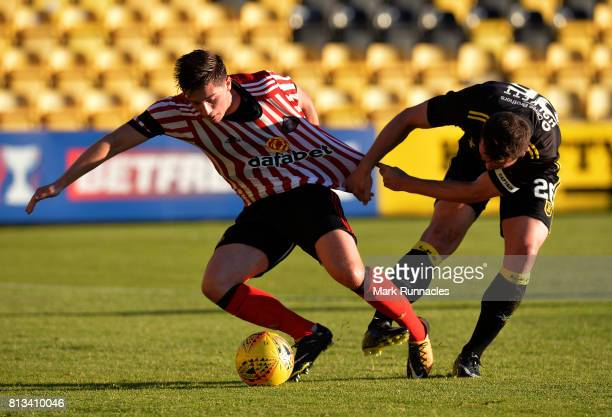 Lynden Gooch of Sunderland and Craig Halkett of Livingston challenge for the ball during the pre season friendly between Livingston and Sunderland at...