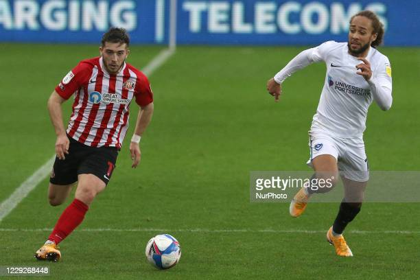 Lynden Gooch of Sunderland and Marcus Harness of Portsmouth challenge for the ball during the Sky Bet League 1 match between Sunderland and...