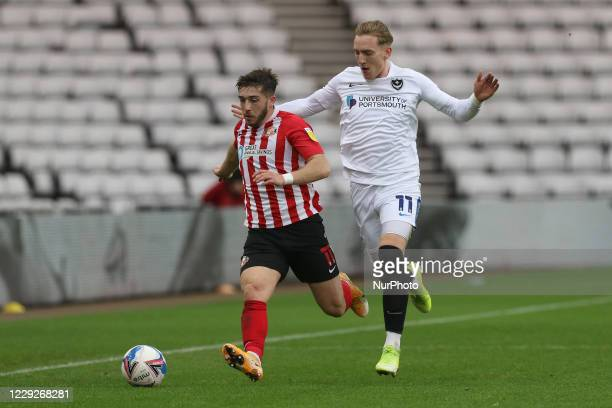 Lynden Gooch of Sunderland and Ronan Curtis of Portsmouth challenge for the ball during the Sky Bet League 1 match between Sunderland and Portsmouth...