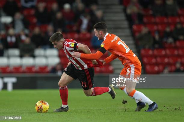 Lynden Gooch of Sunderland battles with Blackpool's Jordan Thompson during the Sky Bet League 1 match between Sunderland and Blackpool at the Stadium...