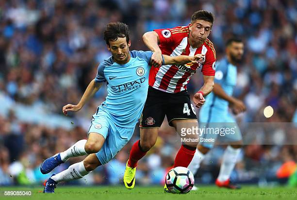 Lynden Gooch of Sunderland challenges David Silva of Manchester City during the Premier League match between Manchester City and Sunderland at Etihad...