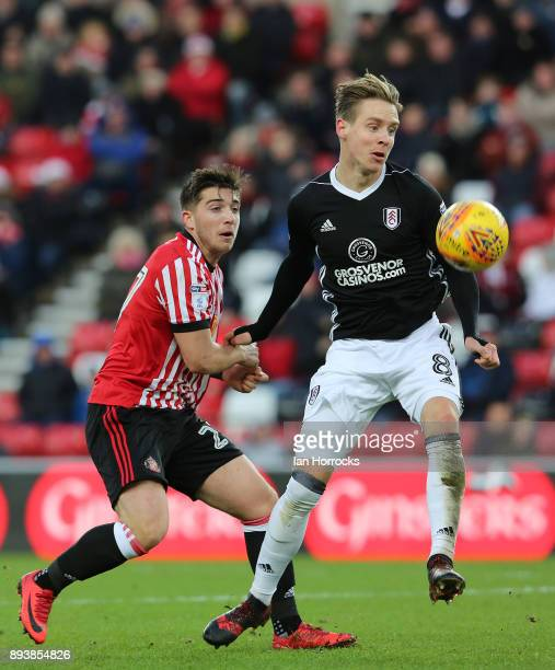 Lynden Gooch of Sunderland competes with Stefan Johansen of Fulham during the Sky Bet Championship match between Sunderland and Fulham at Stadium of...