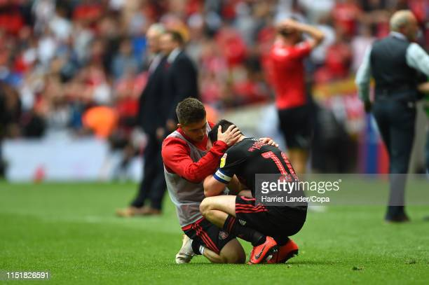 Lynden Gooch of Sunderland consoles teammate George Honeyman of Sunderland following their team's defeat in the Sky Bet League One Playoff Final...