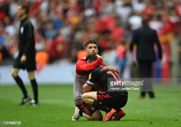 Lynden Gooch of Sunderland consoles teammate George Honeyman of Sunderland following their team's defeat in the Sky Bet League One Play-off Final...