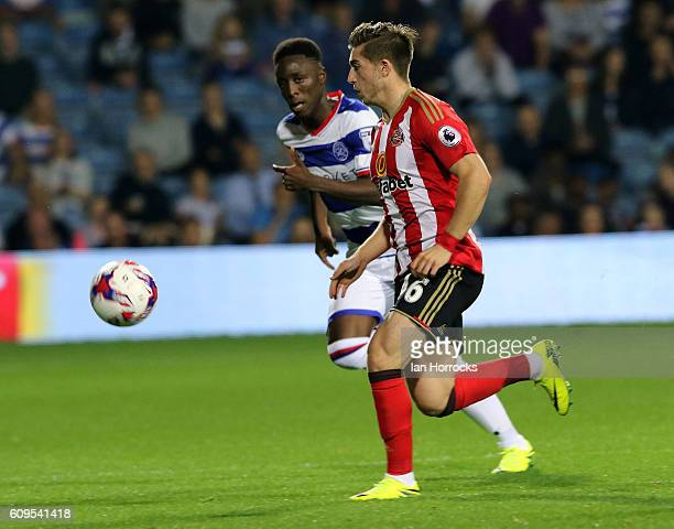 Lynden Gooch of Sunderland is tracked by Osman Kakay of QPR during the EFL Cup third round match between Queens Park Rangers and Sunderland AFC at...