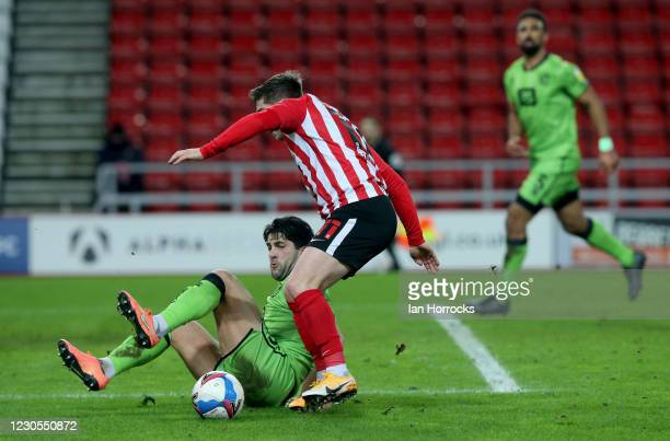 Lynden Gooch of Sunderland tries to escape from Zak Mills of Port Vale during the Papa John's trophy match between Sunderland AFC and Port Vale FC at...
