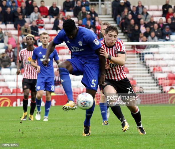Lynden Gooch of Sunderland tries to takes on Bruno Ecul Manga of Cardiff during the Sky Bet Championship match between Sunderland and Cardiff City at...