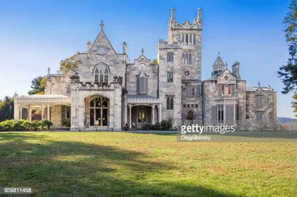 lyndhurst manor, blue sky and trees in autumn colors (foliage) in tarrytown, hudson valley, new york. - westchester county stock pictures, royalty-free photos & images