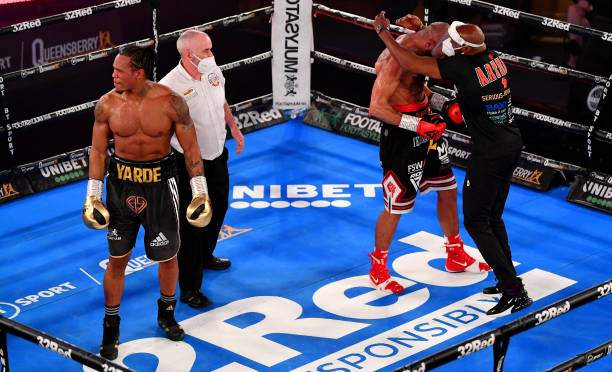 Lyndon Arthur celebrates victory with his trainer Pat Barrett as Anthony Yarde reacts after the Commonwealth Light-Heavyweight Title fight between...