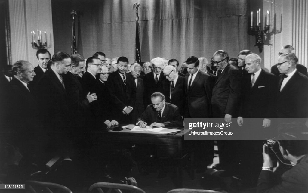 Lyndon Baines Johnson signing Civil Rights Bill, 11 April 1968. Photographer: Warren K Leffler.