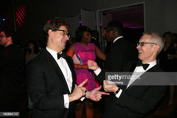 Lyndon Boozer a lobbyist for ATT Inc left talks to Bennett Rink executive director of Alvin Ailey American Dance Theater at the Alvin Ailey American...