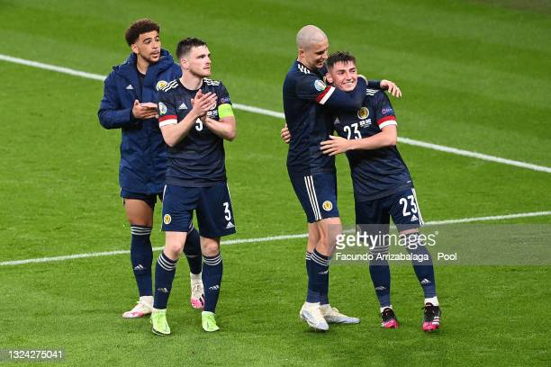 Lyndon Dykes and Billy Gilmour of Scotland interact as team mates Andrew Robertson and Che Adams acknowledge the fans following the UEFA Euro 2020...