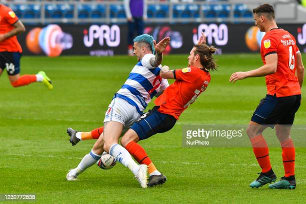 Lyndon Dykes of QPR battles for possession with Glen Rea of Luton town during the Sky Bet Championship match between Queens Park Rangers and Luton...