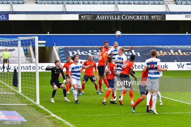 Lyndon Dykes of QPR contests a header with James Bree of Luton town during the Sky Bet Championship match between Queens Park Rangers and Luton Town...