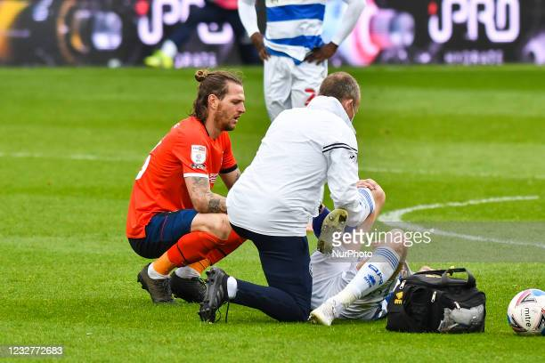 Lyndon Dykes of QPR receives treatment during the Sky Bet Championship match between Queens Park Rangers and Luton Town at Loftus Road Stadium,...