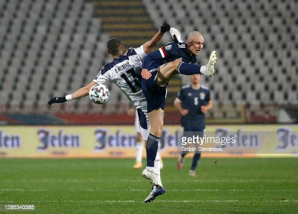 Lyndon Dykes of Scotland battles for possession with in the air with Stefan Mitrovic of Serbia during the UEFA EURO 2020 Play-Off Final between...