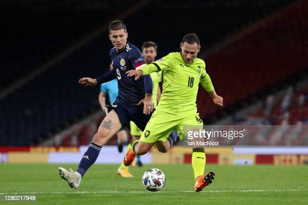 Lyndon Dykes of Scotland battles for possession with Jan Boril of Czech Republic during the UEFA Nations League group stage match between Scotland...