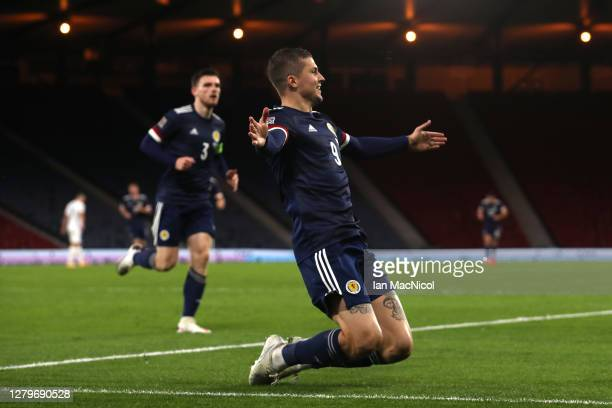 Lyndon Dykes of Scotland celebrates after he scores his team's first goal during the UEFA Nations League group stage match between Scotland and...