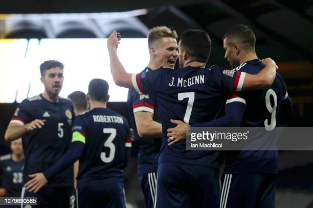 Lyndon Dykes of Scotland celebrates with his team after he scores his team's first goal during the UEFA Nations League group stage match between...