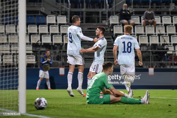 Lyndon Dykes of Scotland celebrates with his teammates after scoring a goal during the UEFA Nations League soccer match between Czech Republic and...