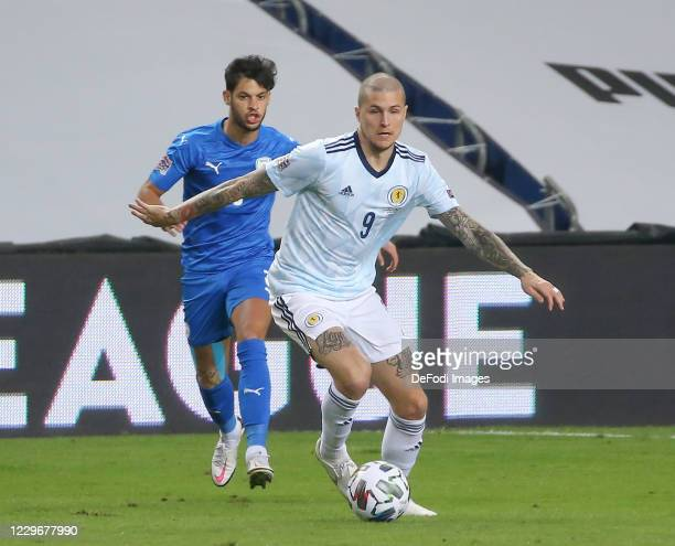 Lyndon Dykes of Scotland controls the ball during the UEFA Nations League group stage match between Israel and Scotland at Netanya Stadium on...