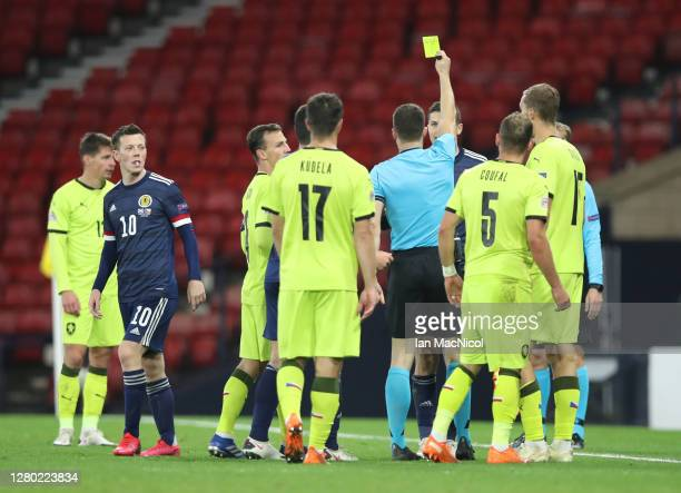 Lyndon Dykes of Scotland is shown the yellow card by Felix Zwayer during the UEFA Nations League group stage match between Scotland and Czech...