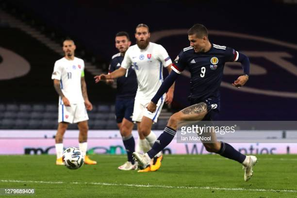 Lyndon Dykes of Scotland scores his team's first goal during the UEFA Nations League group stage match between Scotland and Slovakia at Hampden Park...