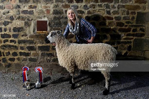 Lyndsey Bainbridge of Reeth poses with her Teeswater Gimmer Shearling which was voted supreme champion during the sheep fair in Masham September 28...