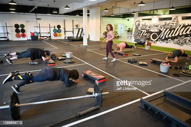 Lyndsey Roberts Strong Like a Mutha company founder teaches gym members during a fitness class on August 31 2020 in Glasgow Scotland Indoor gyms and...